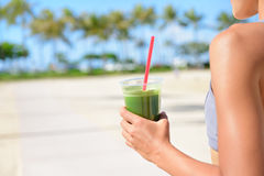 Vegetable green detox smoothie - Woman drinking. Vegetable green detox cleanse smoothie - Woman drinking after fitness running workout on summer day. Girl Stock Photos