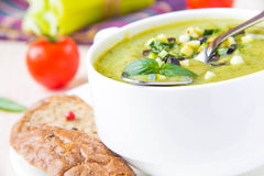 Vegetable green healthy cream soup with avocado, celery, zucchin Royalty Free Stock Photos