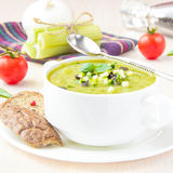 Vegetable green healthy cream soup with avocado, celery, zucchin Stock Photo
