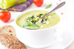 Vegetable green healthy cream soup with avocado, celery, zucchin Royalty Free Stock Images