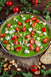 Vegetable Green Omelette with tomatoes, kale, greek cheese, olives, nuts, toast on wooden background. concept healthy Royalty Free Stock Images