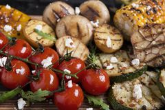 Vegetable grilled tomatoes pepper paprika corn potatoes mushrooms Stock Images