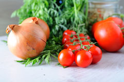 Vegetable groceries on the wooden kitchen table Stock Images