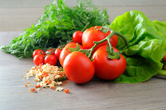 Vegetable groceries on the wooden kitchen table Royalty Free Stock Image