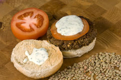 Vegetable hamburger. Veggie burger with sliced tomato and yogurt sauce Stock Photo