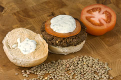 Vegetable hamburger. Veggie burger with sliced tomato and yogurt sauce Stock Photography