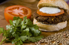 Vegetable hamburger. Veggie burger with sliced tomato and yogurt sauce Stock Photos