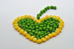 Vegetable heart with stalk. Vegetable heart made from garden peas and sweet-corn kernels with a stalk attached Stock Photography
