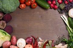 Vegetable ingredients on cooking board, organic food menu. Top view, copy space. Royalty Free Stock Photo