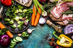 Vegetable ingredients and meat for cooking dishes in a rustic style Royalty Free Stock Photo