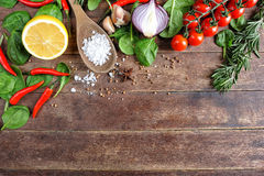 Vegetable ingredients on wooden background Stock Images