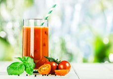 Vegetable juice blend with fresh tomato and basil Stock Photography