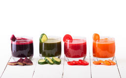 Vegetable juice. (carrot, beet, cucumber, tomato).  on white background with clipping path included Royalty Free Stock Photo