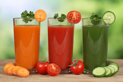 Vegetable juice from carrots, tomatoes and cucumber Royalty Free Stock Images