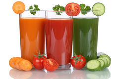 Vegetable juice from carrots, tomatoes and cucumber isolated Royalty Free Stock Image