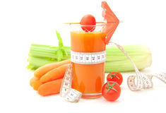 Vegetable juice with tape measure Stock Photos