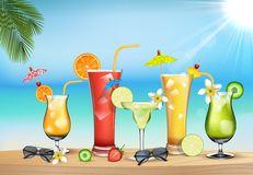 Vegetable juices in the beach Royalty Free Stock Photos