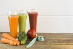 Vegetable juices. Vegetable juice on a white background stock photos