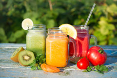 Vegetable juices. On a wooden background royalty free stock photography