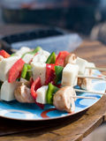Vegetable Kebabs. Vegetable kebab with fresh peppers, mushrooms and haloumi cheese ready for the grill royalty free stock photo