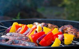 Vegetable kebabs on an outdoor barbecue Royalty Free Stock Photography