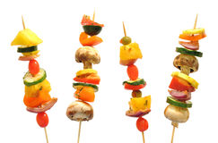 Vegetable kebabs with peppers, mushrooms, zucchini. Healthy veggie kebabs with garden vegetables and pineapple stock photo