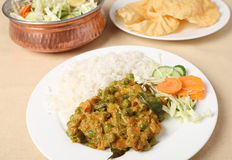 Vegetable korma and salad. A vegetarian Indian meal of vegetable korma, rice and salad with poppadom crisps Stock Photos