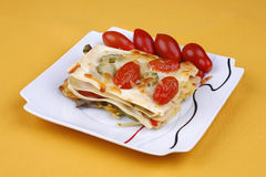 Vegetable lasagna. On a yellow cloth Stock Images