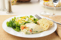 Vegetable lasagna and salad Stock Photos
