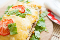 Vegetable lasagna with tomato on top Stock Photography