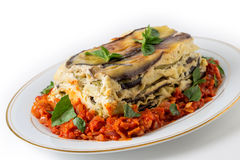 Vegetable lasagne and tomato sauce Royalty Free Stock Image