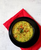 Vegetable,lentil and broken wheat porridge. A very healthy ,quick and delicious porridge made with yellow lentil,vegetable and broken wheat and Indian spices Stock Photo