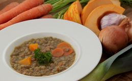 Vegetable lentils soup with pumpkin, carrots and other ingredients. Vegetable lentils soup made from lentils, carrot, pumpkin, leek, onion and garlic Stock Images