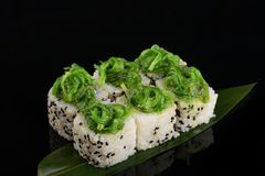 Vegetable maki rolls with seaweed on banana leaf at black background stock photos
