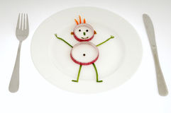 Vegetable man on dish Royalty Free Stock Images