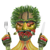 Vegetable man with knife and fork Stock Image
