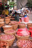 Vegetable market with bacskets of onions in Yangon Stock Photo