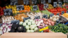Vegetable market defocus background with wooden sheif Stock Photography