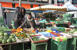 Vegetable market in Geneva. Woman selling egetables in the market in Geneva, Sqitzerland. February 2015 stock images