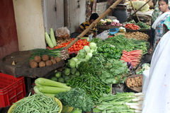 Vegetable market in Kolkata. Seller sells vegetables on the outdoor market on November 28, 2012 in Kolkata. Only 0.81% of the Kolkata`s workforce employed in the Royalty Free Stock Image