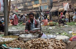 Vegetable market in Kolkata. Street trader sell vegetables outdoor on February 11, 2014 in Kolkata India. Only 0.81% of the Kolkata`s workforce employed in the Stock Photos