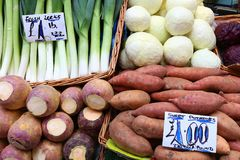 Vegetable market. Leeks, cabbage and sweet potatoes - vegetable shopping at a market place in Leeds, UK stock photos