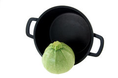 Vegetable marrow and non-stick pan Stock Photos