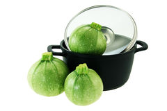 Vegetable marrow and non-stick pan Royalty Free Stock Photography