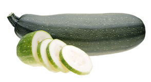 Vegetable marrow with slice. On white background Royalty Free Stock Photo