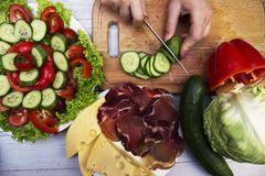 Vegetable, meat and cheese slicing Stock Photos