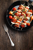 Vegetable and meat on wooden skewers on plate Royalty Free Stock Photography