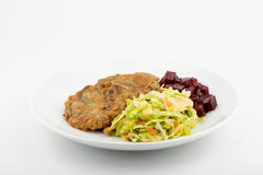 Vegetable meatballs. Garnished with beetroot and cabbage. Front view. Selective focus. White background Stock Image