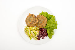 Vegetable meatballs. Garnished with beetroot and cabbage. Top view. Selective focus. White background Royalty Free Stock Photography