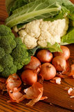 Vegetable medley. Broccoli, cauliflower and shallots on a wooden table Stock Photos
